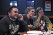 Aaron Hoare, at left, Whitney Gallagher and Erin Leary, of the Johnny's Tavern team, react to Leary's answer to a quiz question Sunday during the sixth annual Irish Pub Quiz at Zig & Mac's, 1540 Wakarusa Drive.