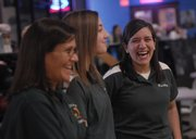 From left Free State bowling coach Anita Carlson and bowlers Christina Picicci and Carlson&#39;s daughter Bailey Carlson visit between frames of the Lawrence Free State and Lawrence High bowling match Tuesday, Feb. 19, 2008.