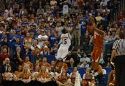 Texas guard A.J. Abrams launches a shot over Kansas guard Mario Chalmers during last year&#39;s championship game of the Big 12 tournament in Oklahoma City. Abrams has become one of the league&#39;s best clutch shooters during his time at UT.