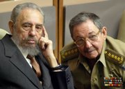 Cuban President Fidel Castro, left, and his brother, Raul Castro, attend a session of Cuba&#39;s parliament in this July 1, 2004, file photo in Havana, Cuba. Fidel Castro resigned Tuesday after nearly half a century in power.