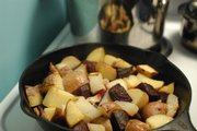A pan of potatoes, onions, beats, garlic, oil and salt simmers on a stove Wednesday, Feb. 13, 2008 at Julie Vernon's house in North Lawrence.