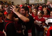Lawrence High's Daniel Green, right, grabs teammate Nathan Padia by the head. Green and Padia's late-game heroics led the Lions to a 43-42 victory over Free State on Dec. 21, 2006.