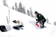 Avalanche ranger Eric White digs a snow pit.