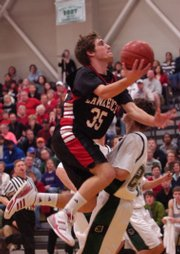 Lawrence High senior Preston Scheibler (35) plows through the Firebird defense.