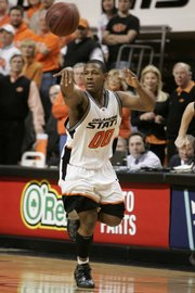 Oklahoma State's Byron Eaton dishes a pass in a game against Texas.