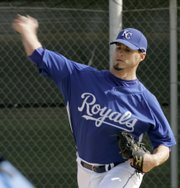 Royals pitcher Gil Meche throws during a workout at the team's complex in Surprise, Ariz.