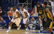 Kansas University's Sherron Collins leads a fast break in a game against Baylor this month at Allen Fieldhouse.