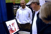 Lawrence architect Daniel Boardman, left, shows John, center, and Marlene Dillard, right, images of his work Sunday, Feb. 24, 2008 during the Lawrence Home Builders Association Home Show at First Serve Tennis Center, 5200 Clinton Parkway.