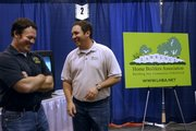 Grant Lechtenberg, left, and Tim Stultz, both of Lawrence, talk while manning the Lawrence Home Builders Association booth Sunday, Feb. 24, 2008 at the Lawrence Home Show at First Serve Tennis, 5200 Clinton Parkway.