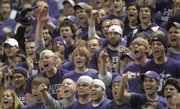 The Kansas State student section yells during the game against Kansas on Jan. 30 in Manhattan. Kansas State has had considerably better luck at home this season. KSU is 6-1 at home, but just 2-4 on the road.
