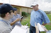 Roger Clemens talks with reporters after arriving at the Houston Astros' spring training facility. Clemens spoke Tuesday in Kissimmee, Fla. Clemens is expected to work out with minor-leaguers at the camp this week.