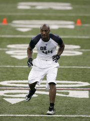 Former Kansas University defensive back Aqib Talib backpedals during a drill. Talib worked out in front of NFL scouts and coaches at the NFL Combine on Tuesday in Indianapolis.