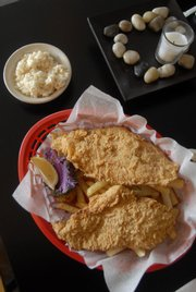 Catfish fillets and fries are served at Midwest Fish Frye and So Much More, 1910 Haskell Ave. The restaurant reopened under new ownership Jan. 14 in time to serve fish and more to customers observing Lent.
