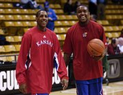 Kansas University's Mario Chalmers, left, and Rodrick Stewart warm up before a game at Colorado earlier this month. Stewart won't play in tonight's game at Iowa State, and the Jayhawks will have to defend oversized guard Wesley Johnson without him.