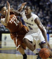 Kansas State guard Jacob Pullen (0) drives past Texas guard D.J. Augustin. Pullen scored 19 points in the Wildcats' 74-65 loss Monday in Manhattan.