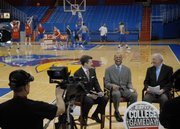 ESPN's College GameDay cast, at center from left, Rece Davis, Hubert Davis and Digger Phelps visit between tapings while the KU men's basketball team has a shoot-around before practice Friday at Allen Fieldhouse. The ESPN crew will air two GameDay shows live from the Fieldhouse today before the KU-K-State game at 8 p.m.