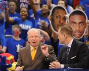 ESPN College GameDay crew members Digger Phelps, left, and Jay Bilas talk strategy live from James Naismith Court at Allen Fieldhouse.
