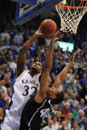 Kansas forward Darnell Jackson bangs in a bucket with a foul from Kansas State forward Ron Anderson during the first half Saturday, March 1, 2008 at Allen Fieldhouse.