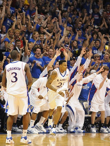 The Allen Fieldhouse crowd erupts after a three-pointer by Brandon Rush, center, during the second half Saturday, March 1, 2008 at Allen Fieldhouse. Left is Kansas guard Russell Robinson.