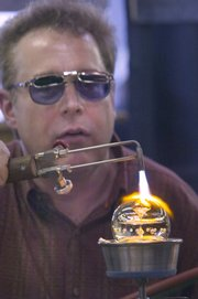 """Marble artist Mark Matthews demonstrates his craft Friday at Marble Crazy in Bonner Springs. Matthews made his """"Super Jetson 3"""" marble at the eighth annual show."""