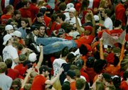Texas Tech students rush the court to celebrate their upset victory against the Texas Longhorns. It was the first time Texas Tech defeated Texas at home since 2005. Texas Tech won, 83-80, in Lubbock, Texas.