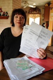Kim Mullen cut up all her credit cards after she filed for bankruptcy in 1993. Since then, the Levittown, N.Y., resident has received a good credit rating. But in December, a debt collector contacted her, saying she had an unpaid card balance of $5,655 from 1992. With interest, the letter stated, the debt had grown to $19,400.