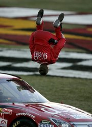 NASCAR driver Carl Edwards does a back flip to celebrate winning the UAW-Dodge 400. Edwards won Sunday in Las Vegas, his second checkered flag in a week.