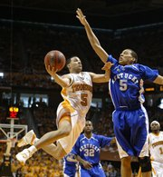 Tennessee's Chris Lofton, left, shoots over Kentucky's Derrick Jasper during the first half. UT won, 63-60, on Sunday in Knoxville, Tenn.