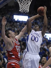 Kansas' Darrell Arthur hits a jumper over Texas Tech's Damir Sulijagic on Monday at Allen Fieldhouse.