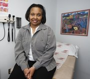 Geraldine Boggs, a Washington, D.C., nurse, poses for a photograph Monday in Washington. Boggs is a participant in a landmark government study about new cancer risks appearing in postmenopausal women after they stop taking hormones, while heart problems linked with the pills seem to fade. Boggs said women should pay attention to the new results.