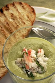 This Bisque of English Peas is topped with crab and mint.