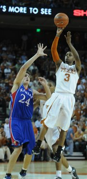 Texas guard A.J. Abrams slips by Kansas center Sasha Kaun for a jumper during the first half Monday, Feb. 11, 2008 at the Frank Erwin Center in Austin.