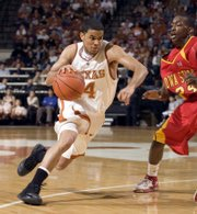 Texas' D.J. Augustin, left, drives around Iowa State's Mike Taylor for two of his 31 points during their  basketball game Saturday, Feb. 10, 2007, in Austin, Texas. Augustin led all scorers as Texas beat Iowa State 77-68.