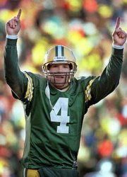 Green Bay quarterback Brett Favre reacts to a touchdown against Dallas in this 1997 photo. Favre, who threw 442 career touchdown passes, on Tuesday announced his retirement.
