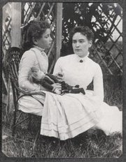This 1888 photo released by the New England Historic Genealogical Society in Boston shows Helen Keller when she was 8 years old, left, holding hands with her teacher, Anne Sullivan, during a summer vacation to Brewster, Mass., on Cape Cod. A staff member at the society discovered the photograph in a large photography collection recently donated to the society.