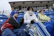 Members of the Collicott family, of Lawrence, bundled up for Kansas University's baseball home opener. From left are Bradley, 9, mom Stacey and Brianna, 11. The Collicotts have had season tickets for the last three years and try to make every home opener. The Jayhawks defeated LeMoyne College, 13-2.