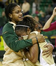 Baylor guard Jhasmin Player, left, comforts teammate Angela Tisdale after Baylor's 72-68 loss to Oklahoma State. The outcome denied Baylor a share of the Big 12 regular-season title.