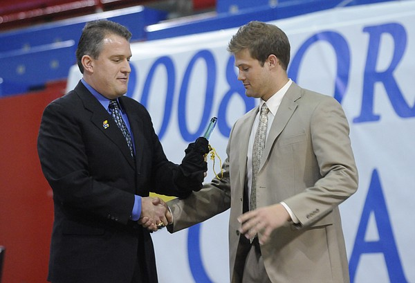 Kansas University Football Offensive Coordinator Ed Warinner, left, presents quarterback Todd Reesing with the 2007 John Hadl Offensive MVP Award on Saturday at Allen Fieldhouse.  KU celebrated their Orange Bowl victory and 12-1 record with fans at the Football Awards Banquet.