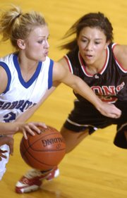 Lawrence High School sophomore Jasmyn Turner, right, guards Goddard High School senior Alysia Hart on Saturday, March 8, 2008 during the Class 6A State Championship game in Emporia.
