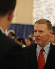Alan Mulally, chief executive officer of the Ford Motor Co., speaks with current and past Kappa Sigma fraternity members at the Dole Institute of Politics. Mulally, a Lawrence native, was presented with the fraternity's 2007 Man of the Year Award Saturday at the reception.