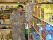 Maj. Scott Holland, of Lansing, shops at Fort Leavenworth's commissary. Holland and his wife said they've seen price increases for some basic items like meat, milk and produce at the grocery store for military personnel. Holland said prices generally are significantly less at the commissary than at grocery stores off-post.