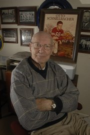 Otto Schnellbacher sits in his home December 31, 2007, with a drawing of himself as a football player at KU. Schnellbacher passed away Monday after a battle with cancer. He was 84.