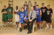 The Journal-World's All-Area boys basketball team is, from left, Weston Wiebe and Kris Wilson, Free State High; Andre Linzy, De Soto; in the foreground center are Perry-Lecompton players Kyle Morgison and Shane Gimzo and coach Jeff Dickson; in the background on the ladder are Baldwin's Dustin Schiller and Drew Berg, followed by Brock McGinnis, Oskaloosa, and John Schneider and Dorian Green, Lawrence High.
