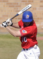 Kansas University's Nick Faunce is drilled by a pitch against Tabor on Tuesday at Hoglund Ballpark.  KU defeated Tabor, 8-1.