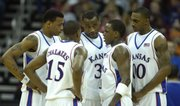The Kansas starters huddle during a timeout as Nebraska mounts their lead during the first half Friday, March 14, 2008 at the Sprint Center in Kansas City, Mo.