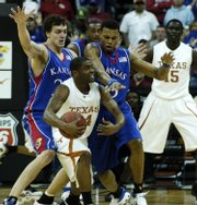 Kansas University's Sasha Kaun, left, and Brandon Rush trap Texas guard Justin Mason during the 2008 Big 12 championship game.  The Jayhawks won three games in three days to claim the tournament title.