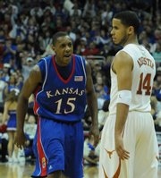 Kansas guard Mario Chalmers talks a little trash to Texas' D.J. Augustin. The Jayhawks' next opponents, the Portland State Vikings, figure to be less daunting than the Longhorns.