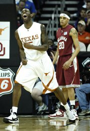 Texas forward Damion James celebrates a thunderous dunk before Oklahoma guard Austin Johnson. UT beat OU, 77-49, Saturday in a Big 12 tournament semifinal at Sprint Center.
