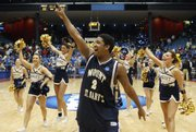 Mount St. Mary's guard Chris Vann (2) celebrates after the Mountaineers defeated Coppin State, 69-60, in the opening round of the NCAA Tournament on Tuesday in Dayton, Ohio.