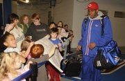 Kansas University's Russell Robinson is cheered by kids from Children's Learning Center who came to see the Jayhawks off as they left Tuesday for Omaha, Neb.